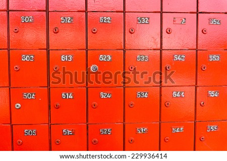 Rows of red locked post office boxes - stock photo