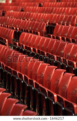 Rows of red seats at Old Trafford, the Theatre of Dreams