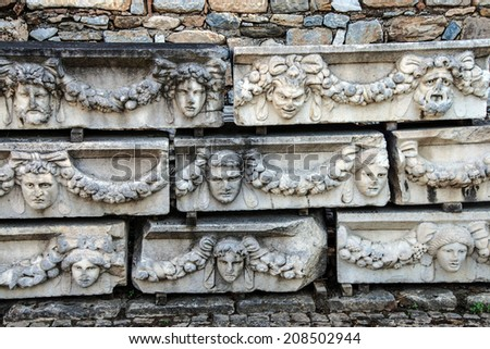 Rows of sculpted Greek masks  recovered from the ruins of the theatre of  Aphrodisias,  Turkey