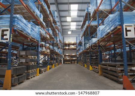 Rows of shelves in commercial lighting factory