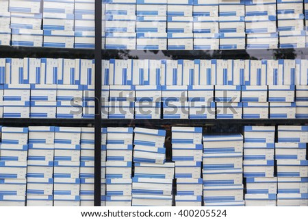 Rows of shelves with boxes - stock photo