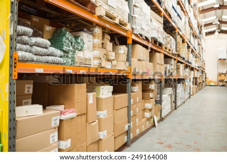 Rows of shelves with boxes in a large warehouse