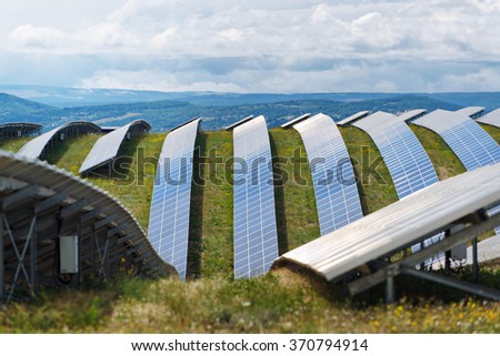 Rows of solar panels in the field on a plateau - stock photo