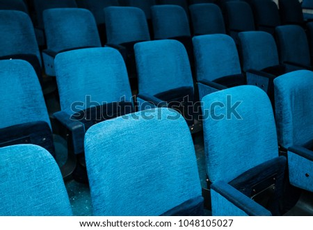 Rows of the Empty chairs in the theater