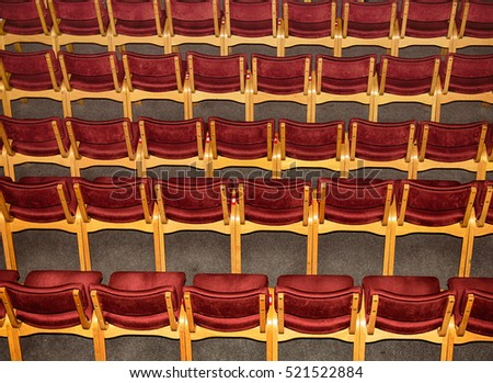 Rows of the Empty chairs in the theater, top view.