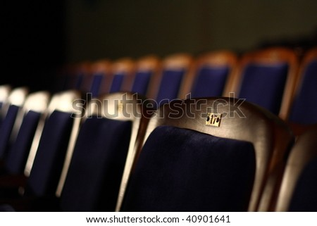 Rows of theater or cinema seats - stock photo
