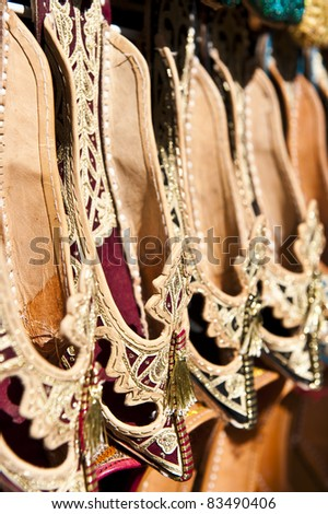 Rows of typically oriental shoes at the market in Dubai, shallow DOF. - stock photo