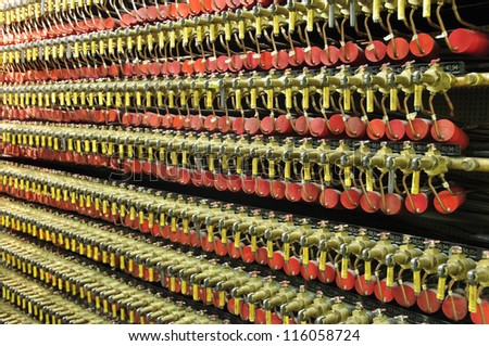 """Rows of valves and gauges in the """"B"""" Reactor, the first fully functional nuclear reactor in the world, at the Hanford Site in Washington state. - stock photo"""