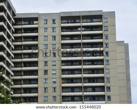 rows of windows on apartment - stock photo
