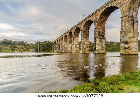 Royal Border Bridge / The Royal Border Bridge at Berwick is a viaduct that supports the main east coast railway line over the River Tweed - stock photo