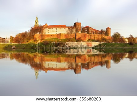 Royal castle of the Polish kings on the Wawel hill, over the Vistula river in the evening, Kwakow, Poland - stock photo