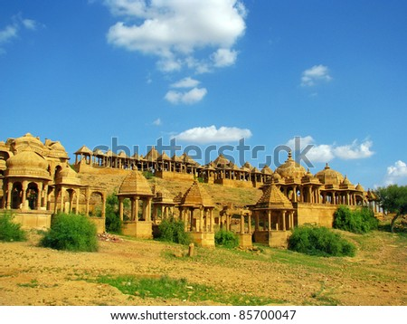 "Royal cenotaphs of Bada Bagh in Jaisalmer, the magnificent ""Golden City"" in the heart of Rajasthan (India), surrounded by the desert of Thar - stock photo"