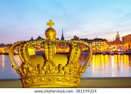 Royal crown and Stockholm cityscape at night, Sweden - stock photo