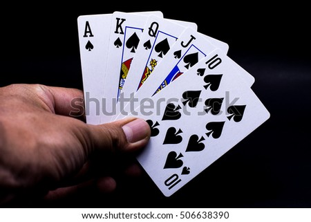 royal flush playing cards, Ace, King, Queen, Jack and ten of Spades.