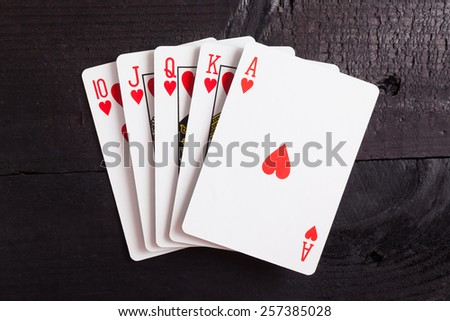 Royal flush. Playing cards isolated on a black background  - stock photo