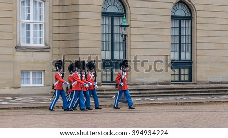 Royal Guards marching in the ceremony of changing the guards on the square at Amalienborg Castle, Copenhagen, Denmark - stock photo