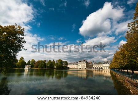 Royal hunting castle Fontainbleau near Paris in France and lake. - stock photo