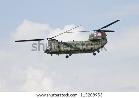 ROYAL INTERNATIONAL AIR TATTOO, FAIRFORD, UK - JULY 08: Boeing CH-47 Chinook military transport helicopter performing display at the Royal International Air Tattoo, RAF Fairford, July 08, 2012.