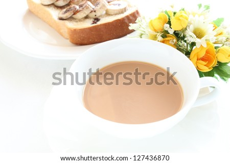 royal milk tea and banana toast witn flower on background for restaurant image