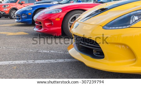 ROYAL OAK, MI/USA - AUGUST 13, 2015: Three Dodge SRT Vipers at the Woodward Dream Cruise. Woodward is a National Scenic Byway. - stock photo