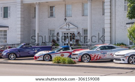 ROYAL OAK, MI/USA - AUGUST 13, 2015: Three Team Penske Official Indy 500 pace cars at the Woodward Dream Cruise. Woodward is a National Scenic Byway. Woodward is a National Scenic Byway. - stock photo