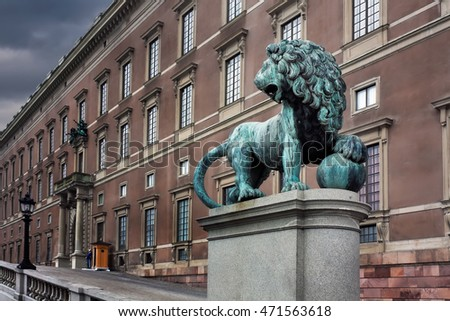 Royal palace and statue of a lion in Stockholm, Sweden.
