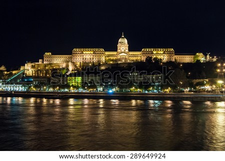 Royal Palace or Buda Castle at evening, Budapest in Hungary. With night illumonation reflected in Danube river
