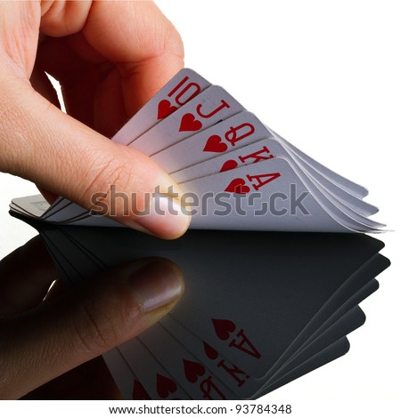 Royal poker in the hand with reflection - stock photo