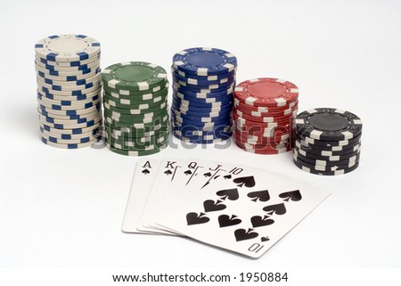 Royal straight flush poker hand with chips.