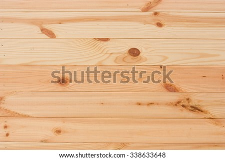 Royalty free stock photo of a light wood texture - background image; sample of the wood with very nice tree rings
