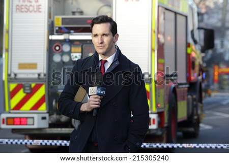 ROZELLE, AUSTRALIA - SEPTEMBER 4, 2014; ABC News Reporter at the scene covering the tragic incident Rozelle after a suspicious shop explosion claimed the lives of three people and inured others. - stock photo