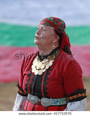 ROZHEN, BULGARIA, JULY 15, 2016: Woman in traditional folk costume of famous rozhen folklore festival in bulgaria