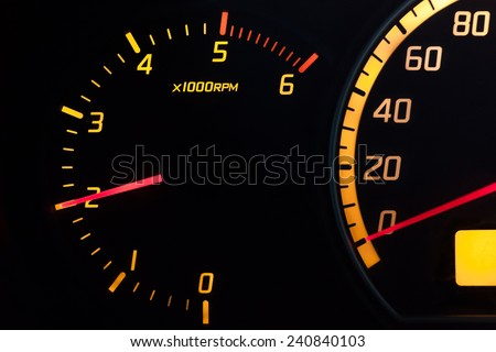 RPM  tachometer meter showing engine running at 2000 RPM. Isolated analog dial with yellow glowing numbers and red needle.