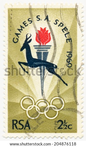 RSA - CIRCA 1969: A stamp printed in RSA shows Springbok, Torch and Rings, South African National Games, Bloemfontein, circa 1969