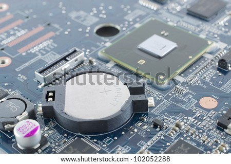 rtc battery in notebook motherboard - stock photo