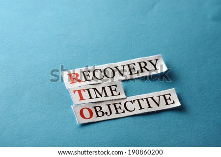 RTO acronym  - Recovery Time Management , words on cut paper hard light - stock photo