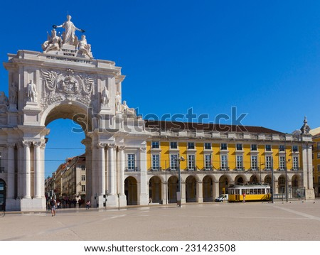 Rua Augusta Arch is a triumphal arch-like, historical building and visitor attraction in Lisbon on Commerce Square at day. Portugal - stock photo