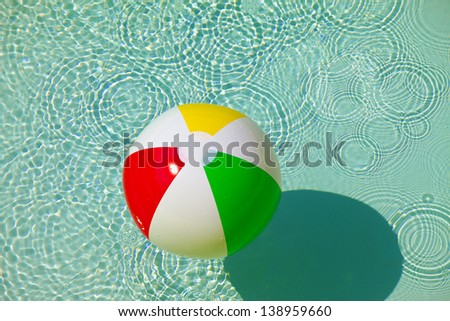 Rubber ball in a pool - stock photo
