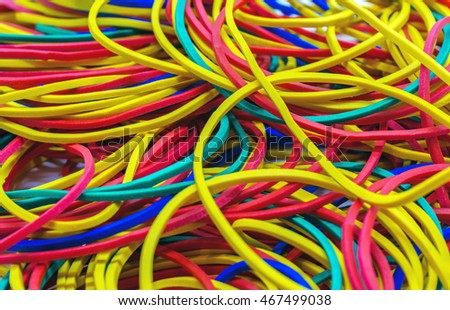 Rubber bands for money, colored background
