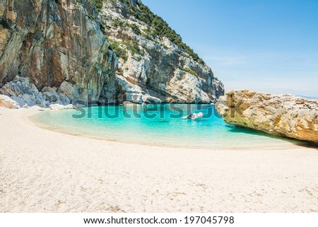 rubber boat in Cala Mariolu, Sardinia - stock photo