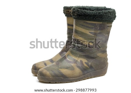 rubber boots on the white background