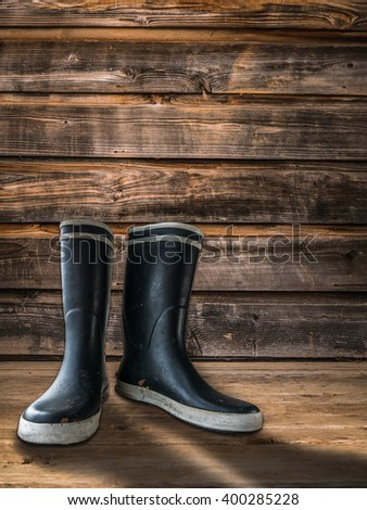 Rubber Boots Or Wellingtons On The Porch Of A Farmhouse Or Homestead - stock photo