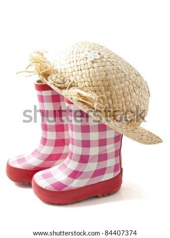 Rubber boots with straw head isolated over wiite - stock photo