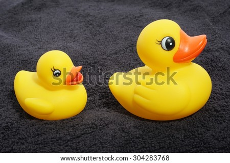 rubber duckies on a towel - stock photo