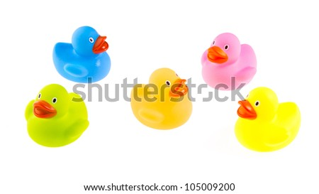 Rubber ducks isolated on a white background - stock photo