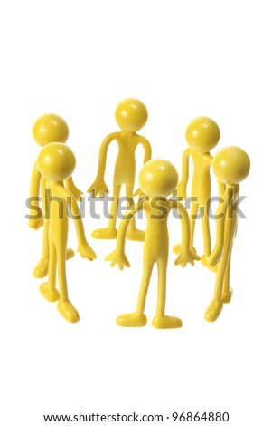 Rubber Figures in Circle on White Background - stock photo