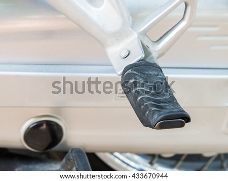 Rubber foot pedal of the old motor cycle in the garage. - stock photo