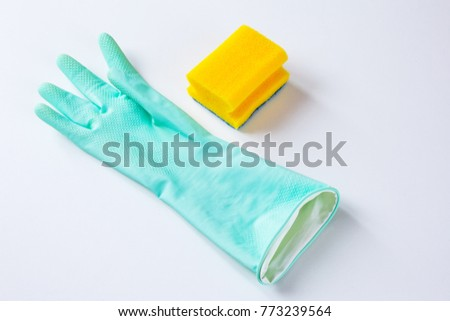 Rubber glove and a yellow cleaning sponge at white background