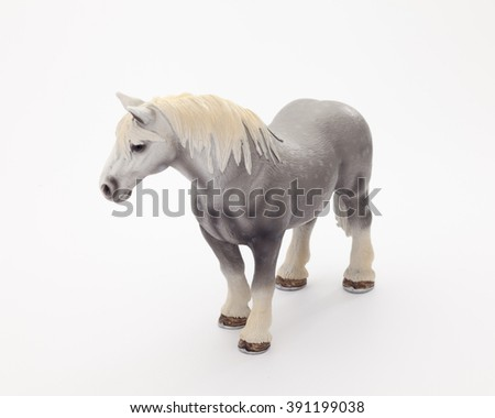 Rubber horse realistic toy - white background isolated - stock photo
