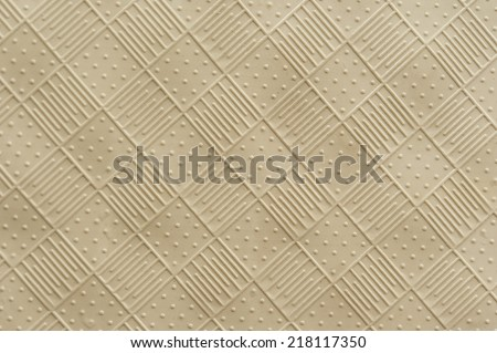 rubber mat texture of raised squares with alternating lines and dots - stock photo